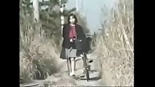 Schoolgirl on bicycle