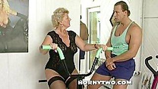 Horny granny whore shamelessly takes gym traine...