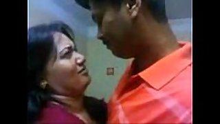 Tamil pair giving a kiss boob engulfing -