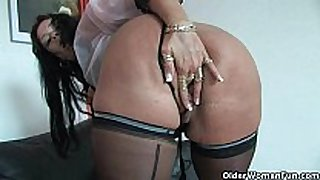 Sleazy mammas in corset and stockings having solo...