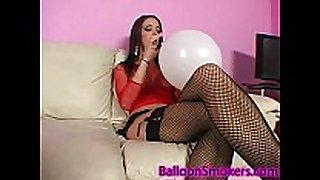 Teen blows up balloons in fishnet top and high ...