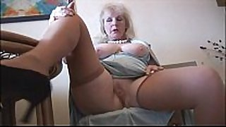 Curvy mature dark ramrod bitch in stockings strips and poses