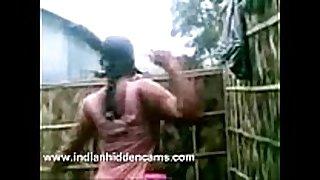Indian dark dong sluts from village taking open air shower...