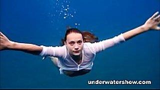 Julia swimming undressed in the sea