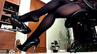 Sexy legs and heel dangling