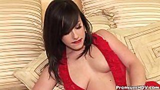 Busty in red teasing on ottoman