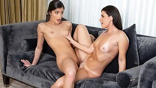 Horny MILF India Summer playing with young girl on the couch