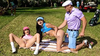 Petite golf player with small cans shagged outdoors